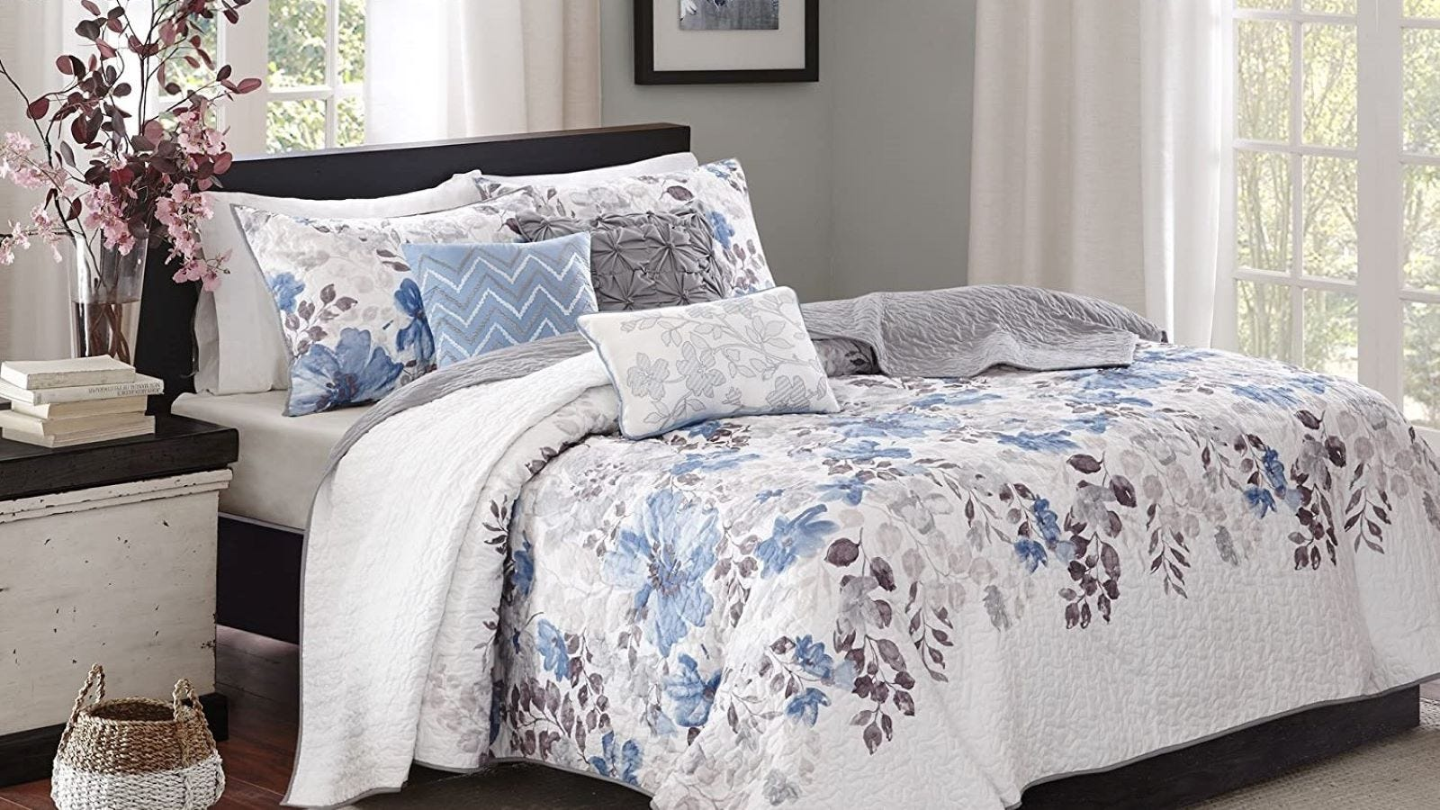 Madison Park Modern Quilt and throw pillows in Luna Floral Blue on a Queen size bed.