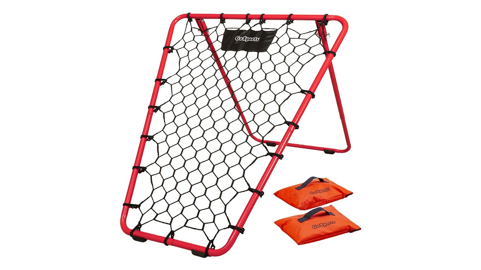 A rectangular-shaped basketball rebounder with a red frame and two orange sandbags beneath it.