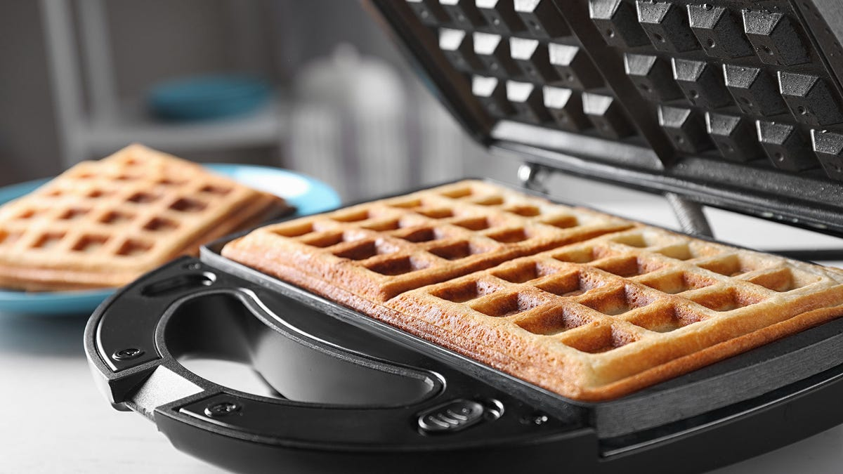 A waffle maker with a square waffle grid.
