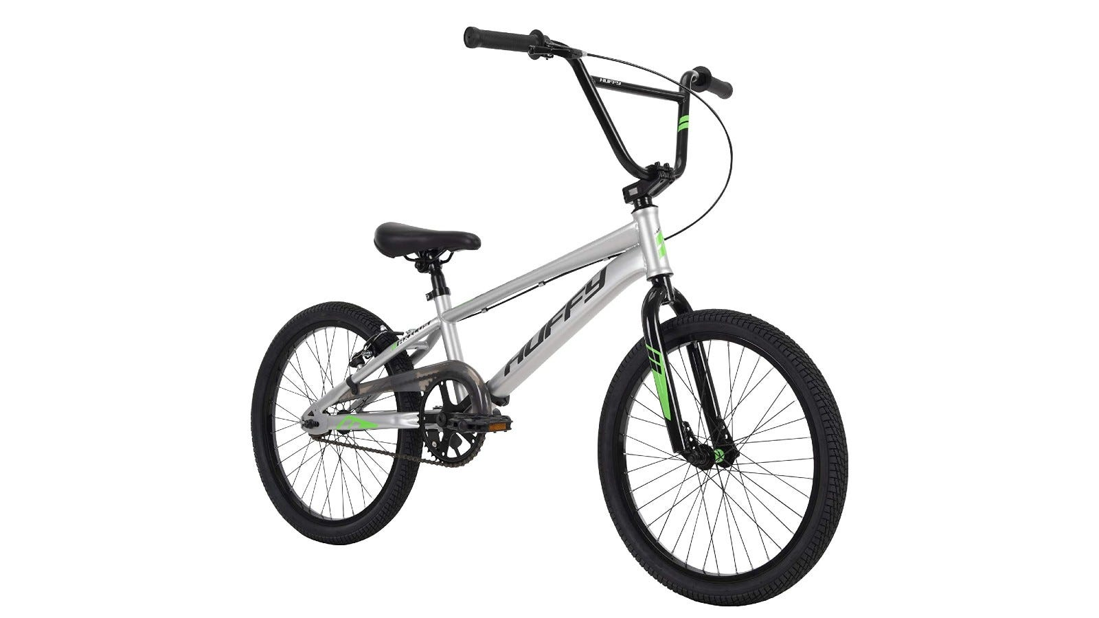 A silver Huffy BMX bike with green and black accents