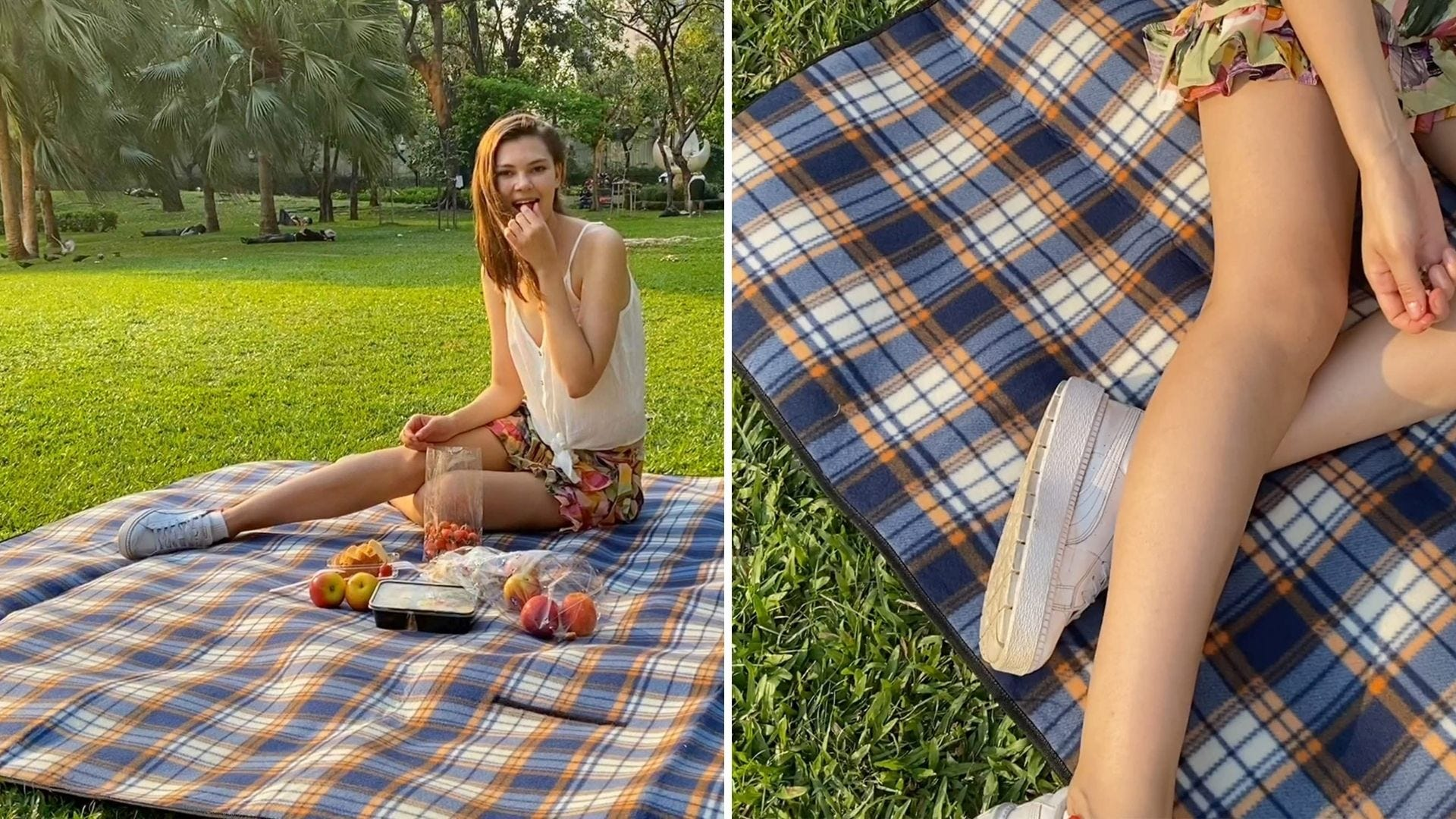 A woman sits on a picnic blanket outside