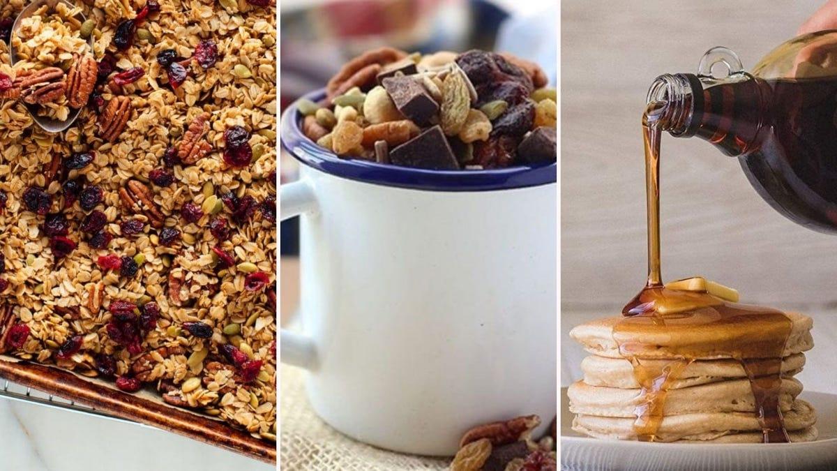 A pan of homemade granola, a mug full of trail mix, and Kodiak Cakes pancakes and syrup.