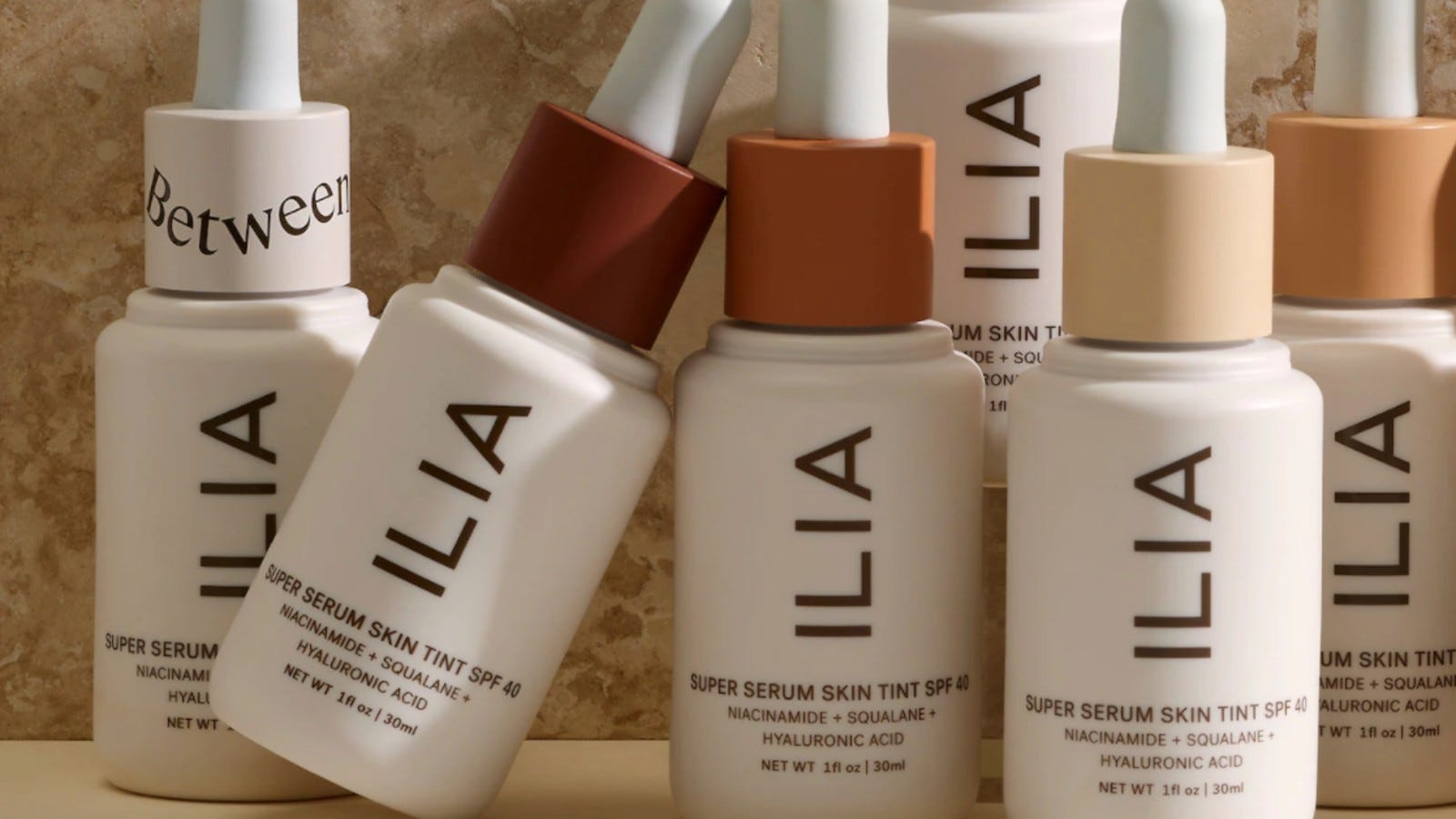 different bottles of Ilia Super Serum Skin Tint in various shades