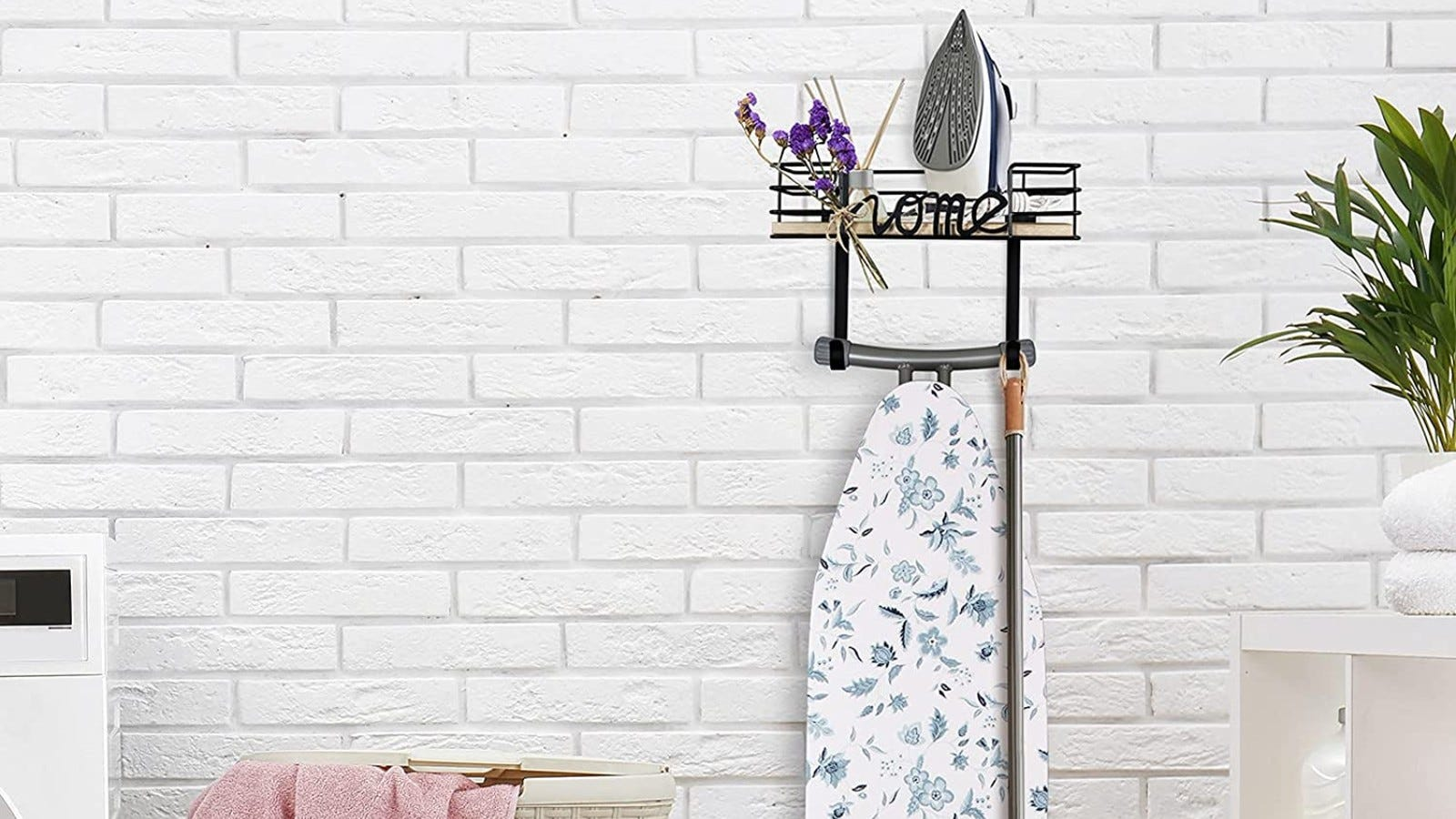 ironing board shelf holder hanging on the wall with an iron and flowers