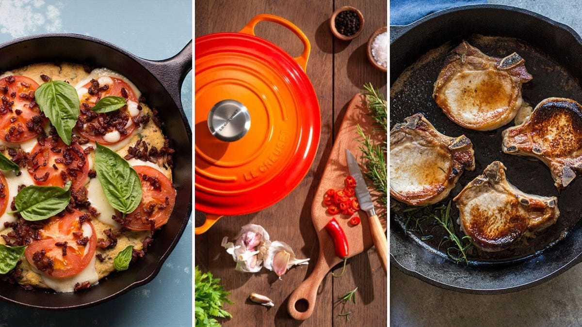 Three cast iron pans, including one that is orange enameled