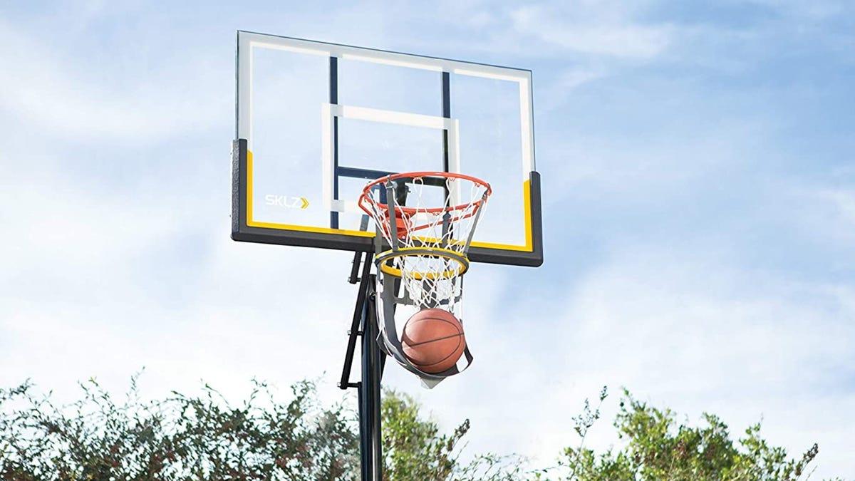 A basketball rebounder installed on a residential basketball hoop.