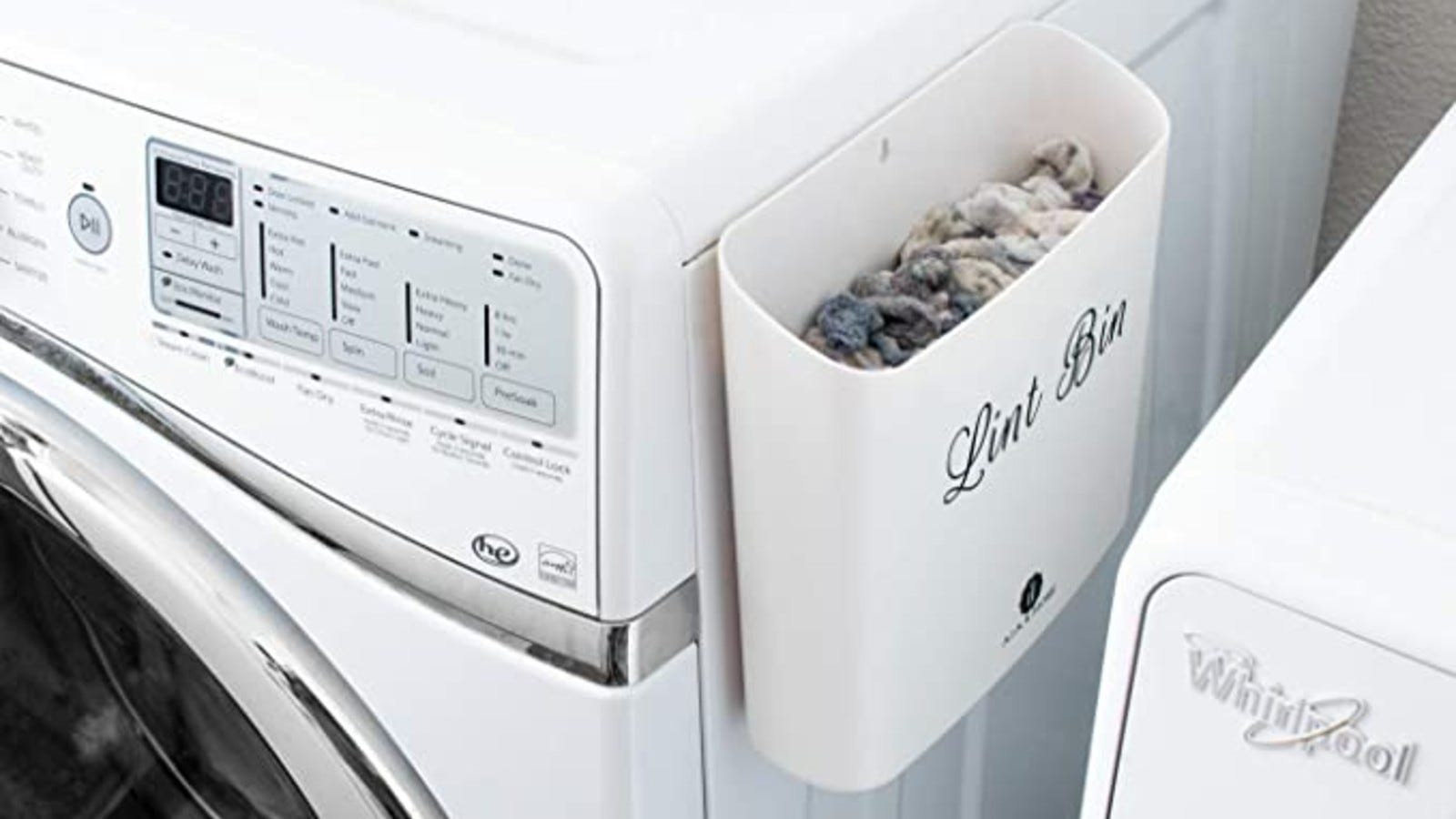 white lint bin attached to the side of a washing machine