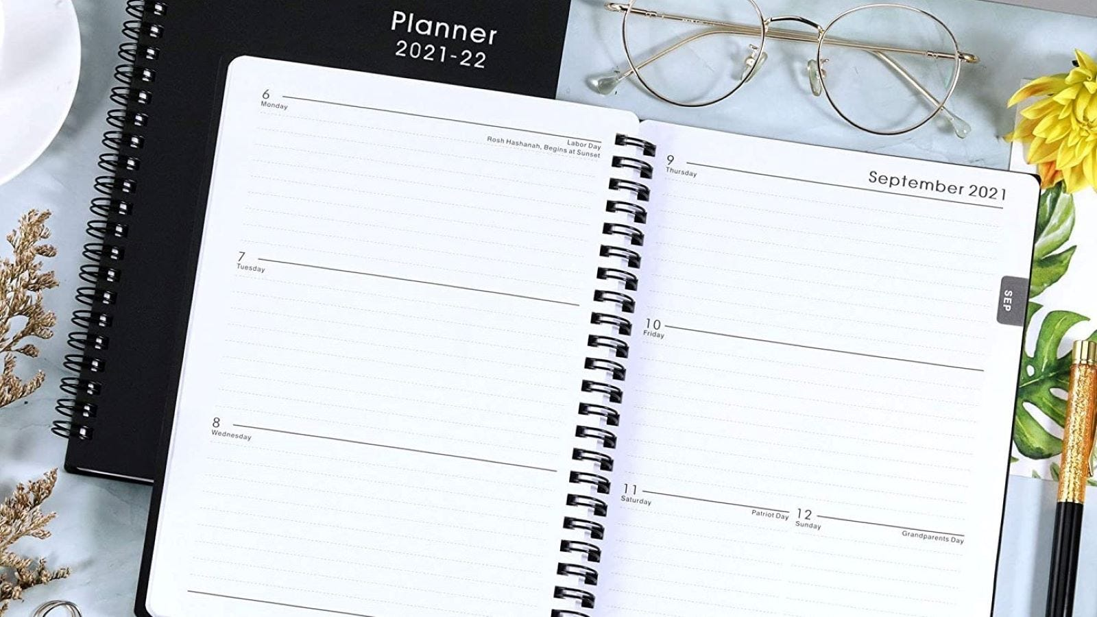 An open Maalbok Academic 2021-22 Planner showing a two-page spread in September.