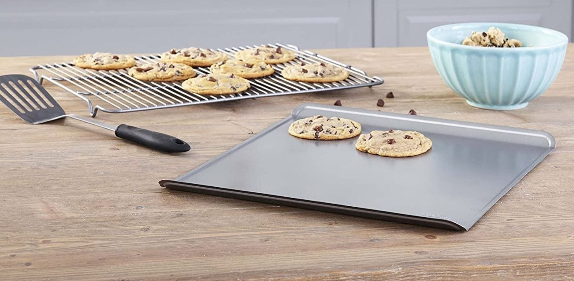 Chocolate chip cookies on two Chicago Metallic sheet pans.