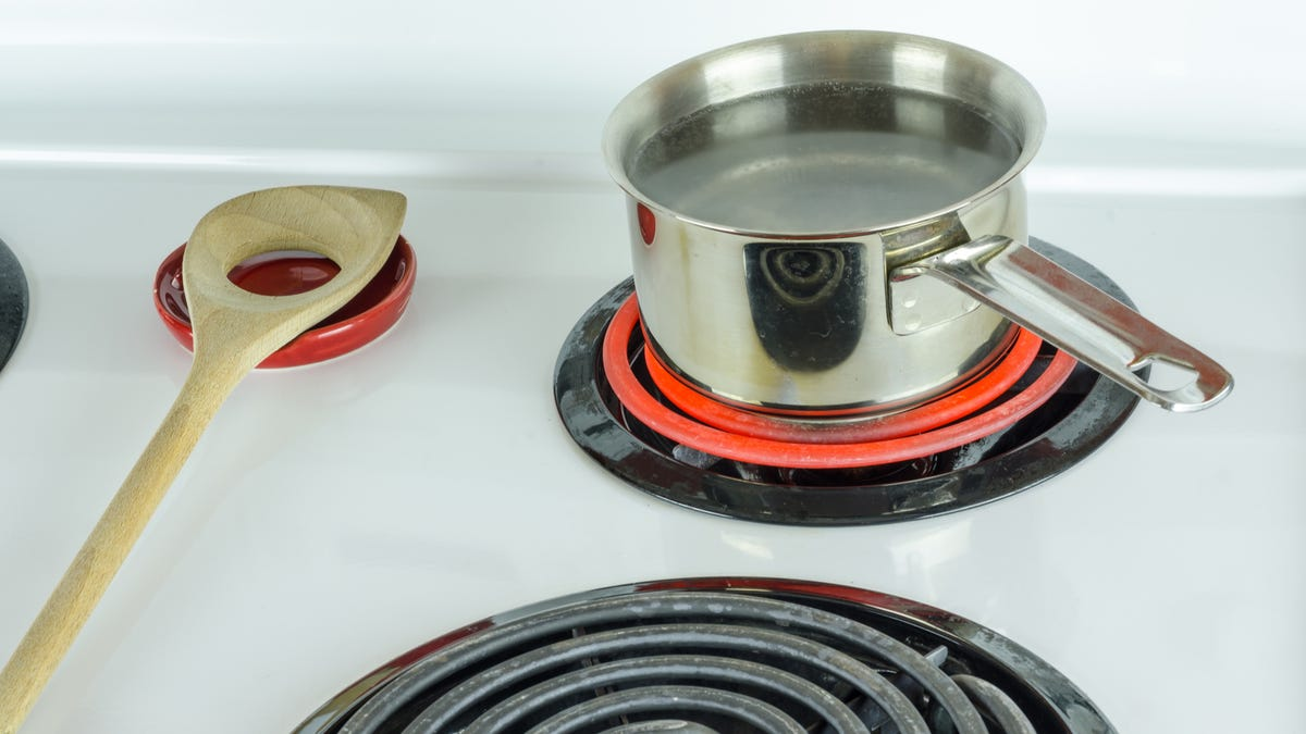 A steel pan sits on top of a hot stove eye.