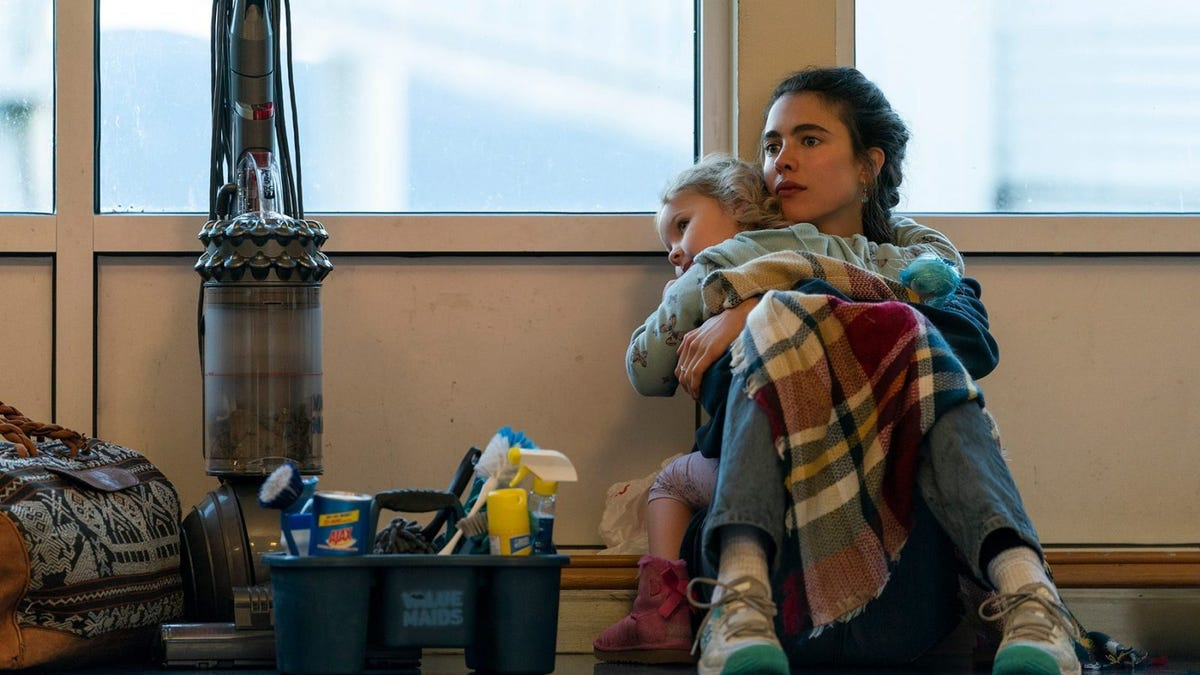 Margaret Qualley holding a little girl in a scene from 'MAID.'