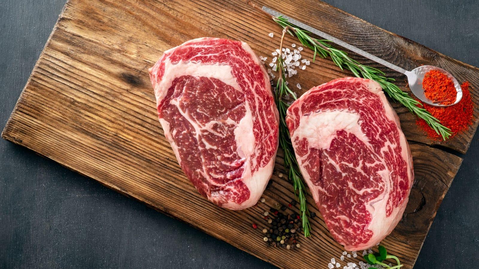 Two ribeye steaks displaying really nice marbling througout both cuts.