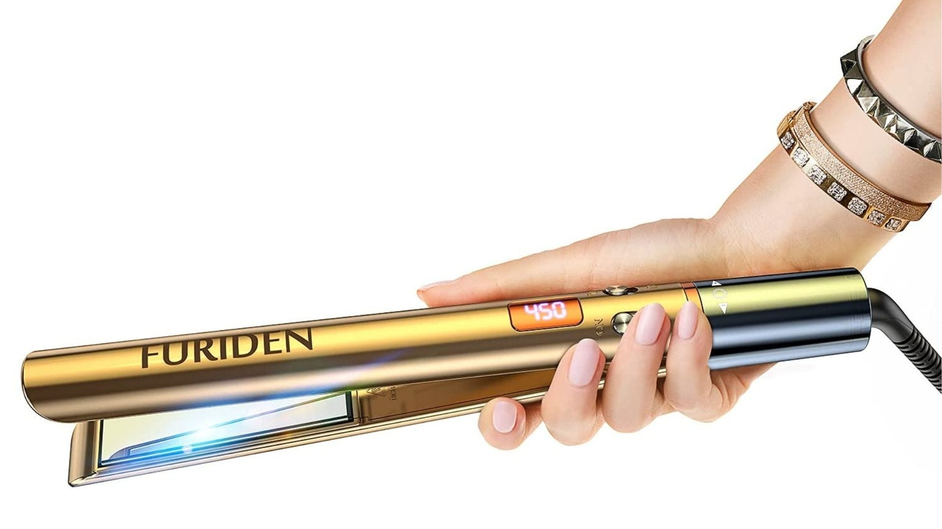 Someone holds a gold hair straightener in their hand