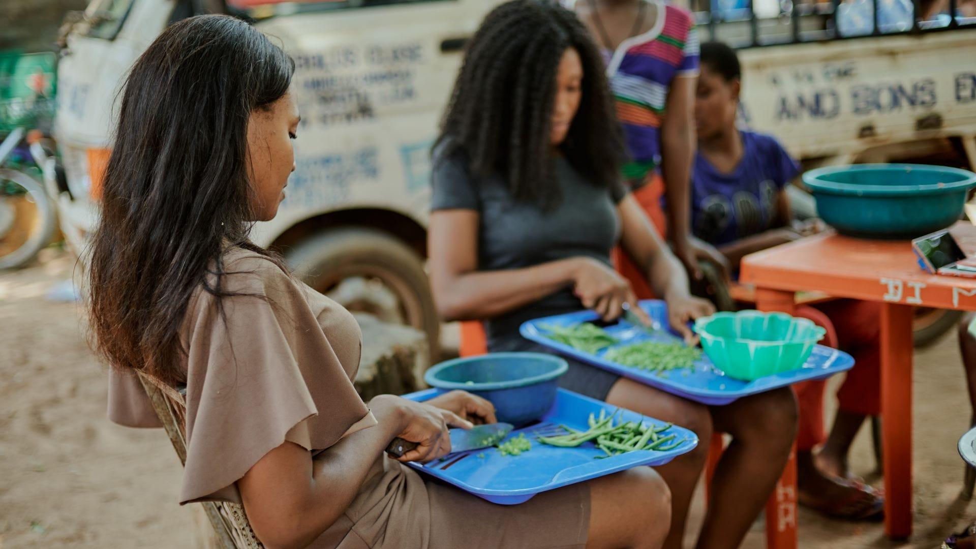 Women cutting vegetablles in Nigeria.