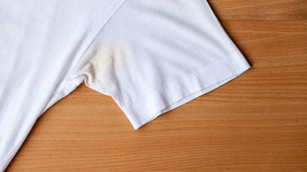 A white t-shirt sleeve has a yellow stain in the armpit.