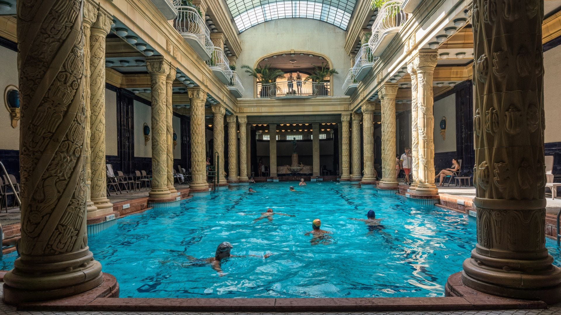People in the St. Gellert Thermal Bath and Swimming Pool in Budapest.