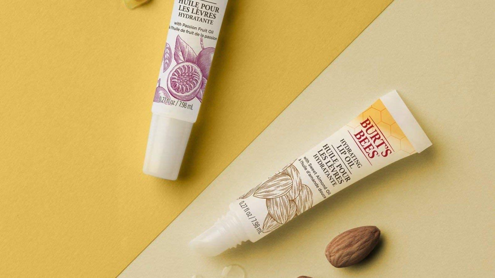 tube of burt's bees lip oil on yellow background