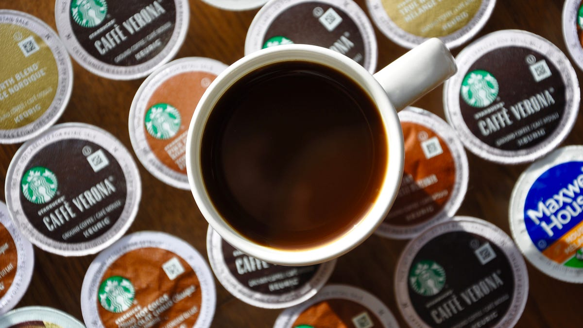 A cup of coffee sits on top of multiple K-cups