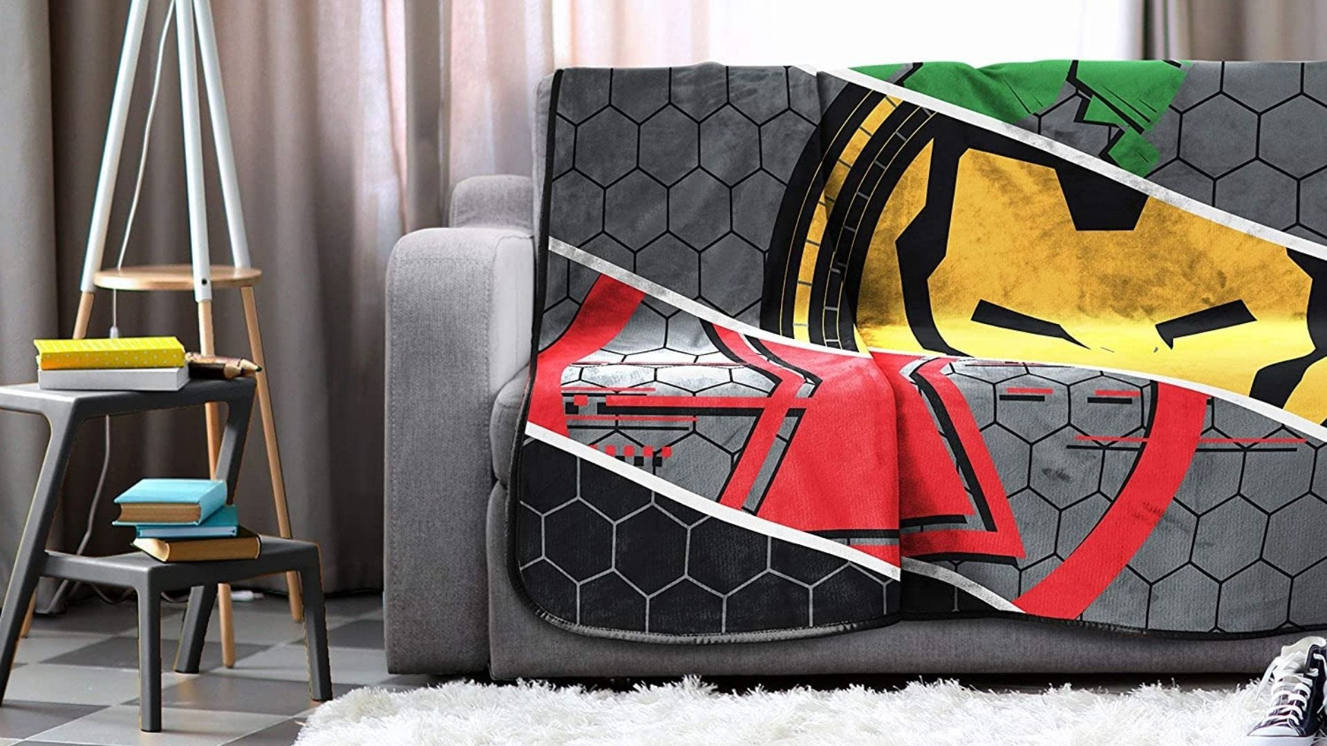 A Marvel blanket on a couch
