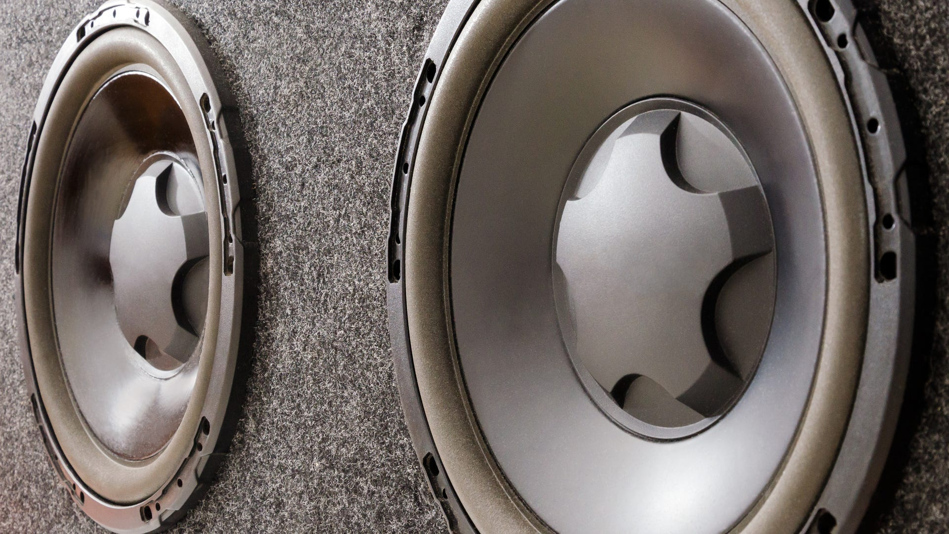 A subwoofer box for a car with two subwoofer speakers.
