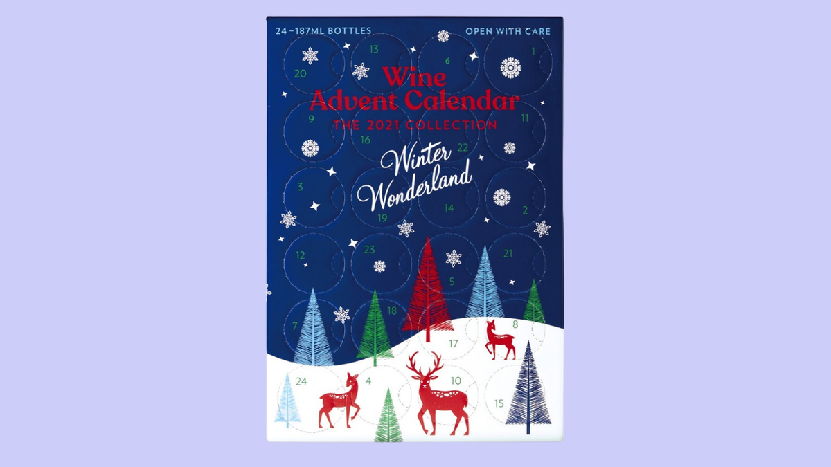 A wine advent calendar features reindeer and christmas tree decor.