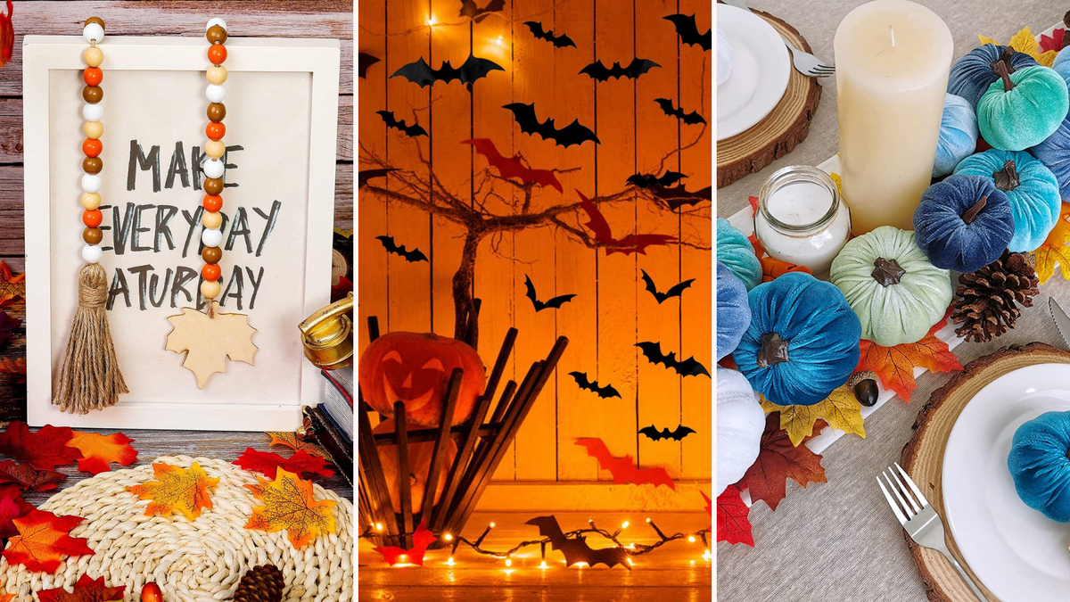 A sign is draped with beads, bats are attached to a wall, and blue pumpkins sit on a table.