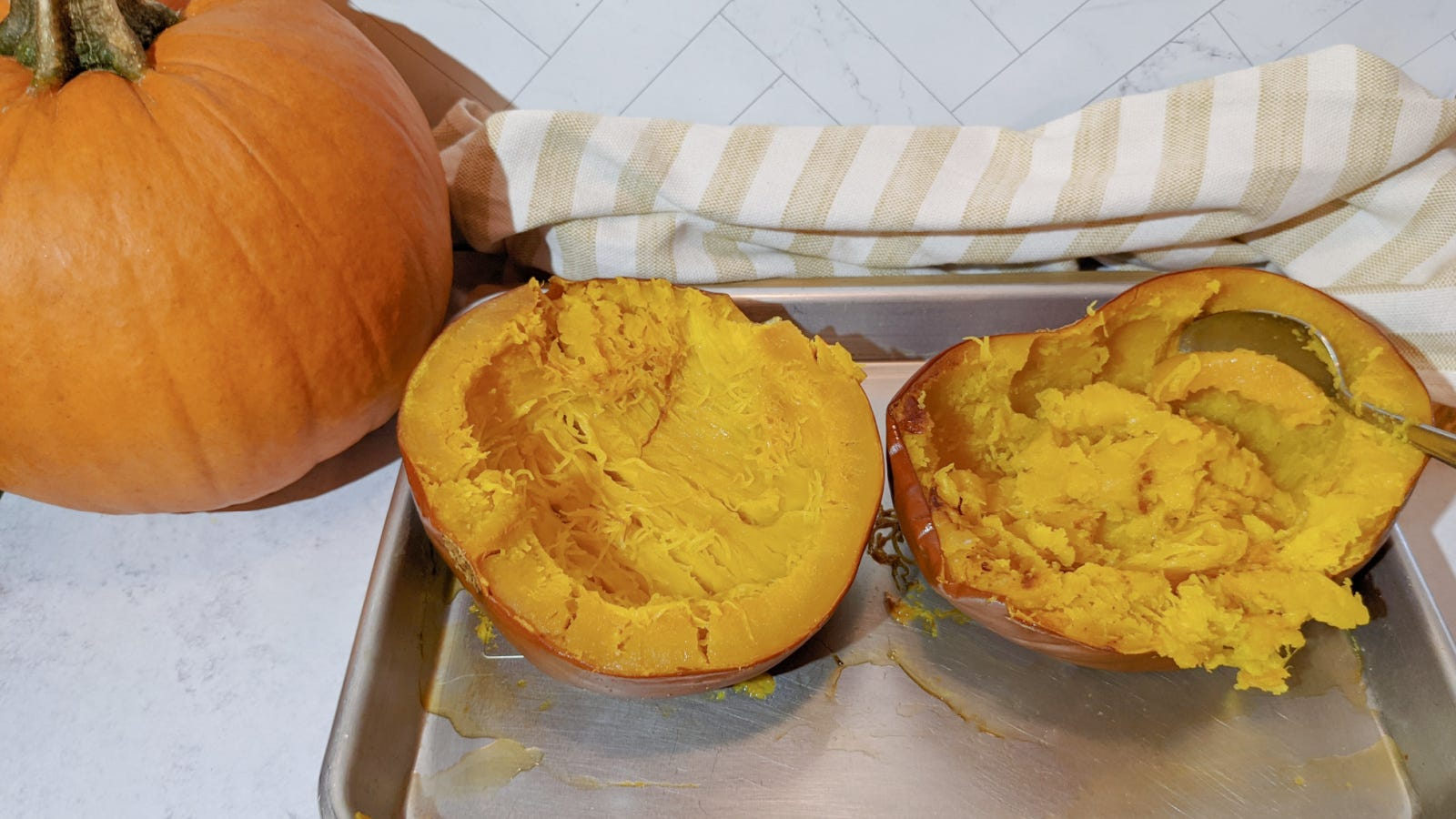 A sugar pumpkin fresh out of the oven, with the inside squash softened and cooked.