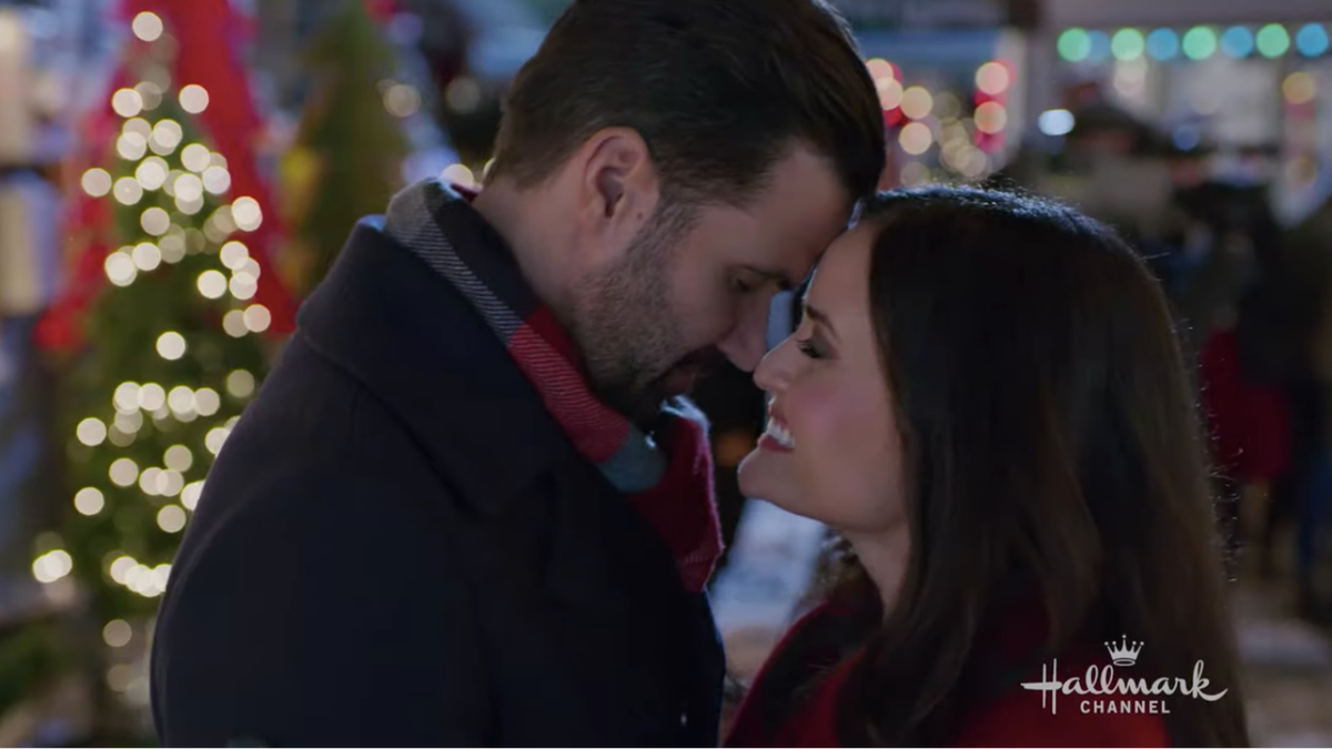 Benjamin Ayres and Danica McKellar in a scene from 'You, Me & the Christmas Trees'.