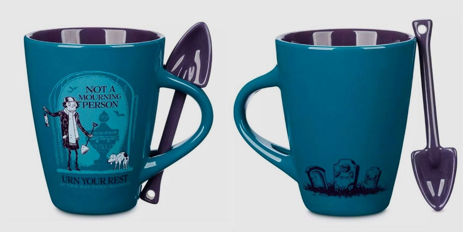 """Front and back view of a """"Not a Mourning Person"""" coffee mug and shovel-shaped spoon"""