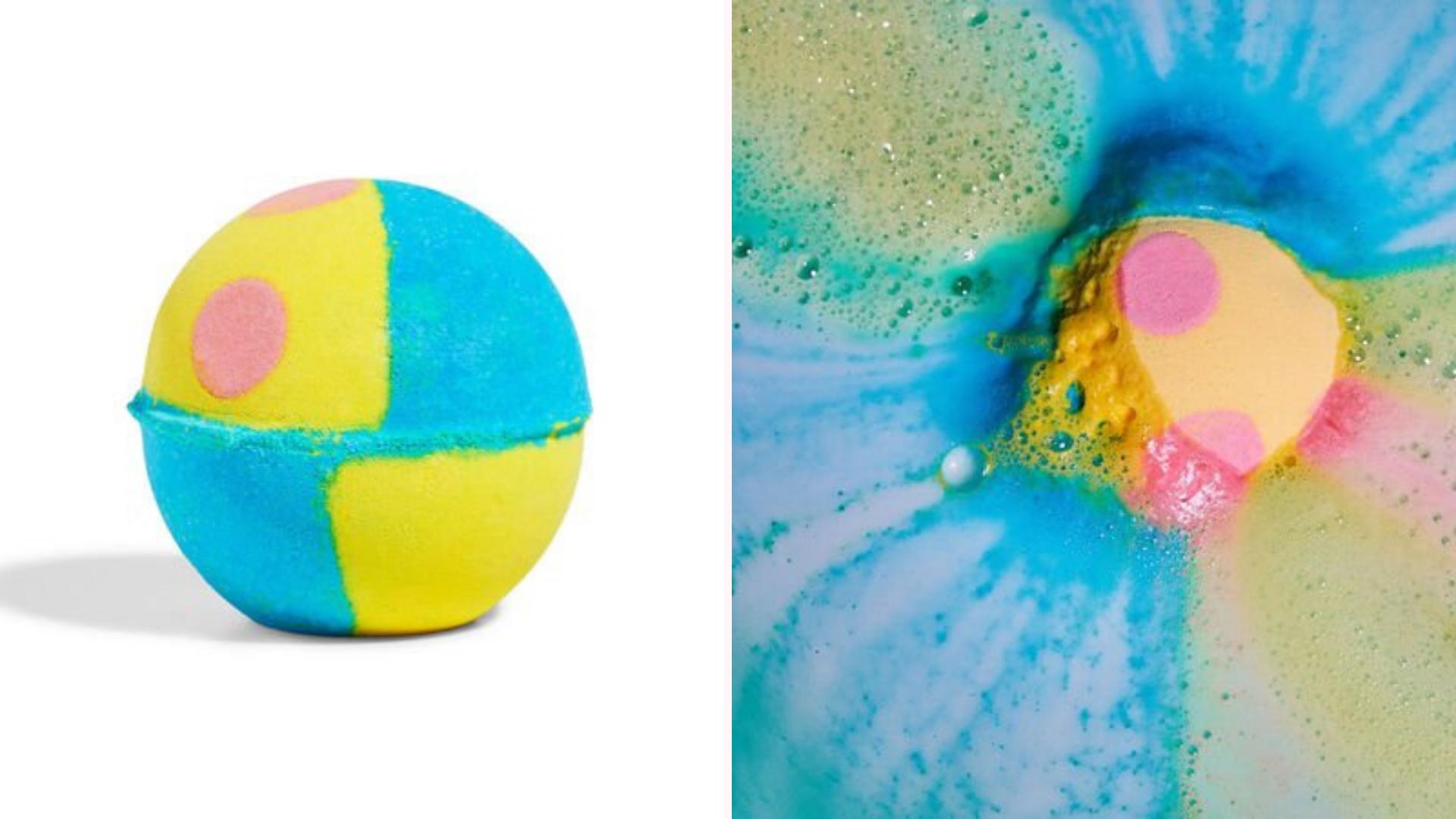 A bath bomb emits yellow and blue colors