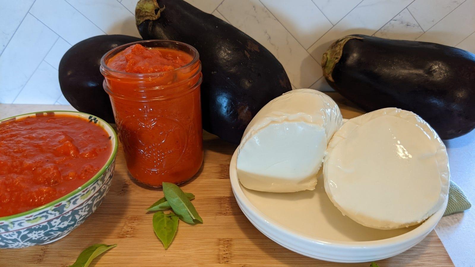 Various ingredients including globe eggplant, marinara sauce, fresh mozarella and fresh basil.