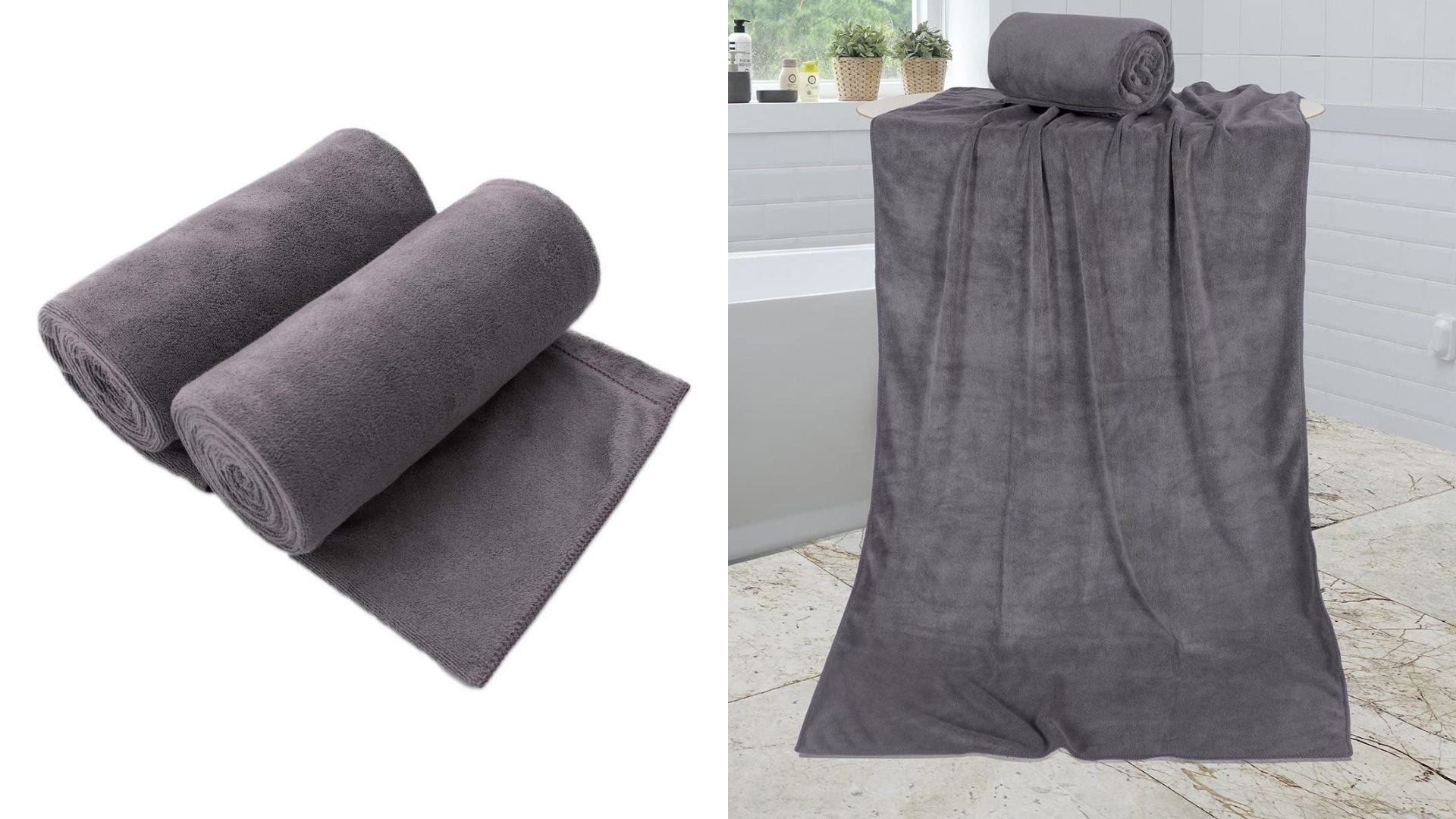 Two large gray towels rolled up and one hanging over a table