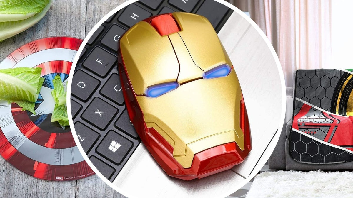 A Captain America cutting board, a computer mouse shaped like Iron Man's helmet, and a blanket on a couch