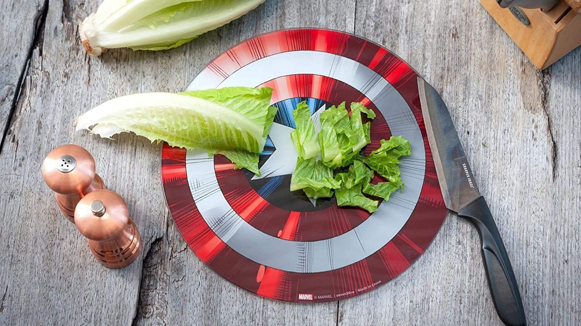 A cutting board shaped like Captain America's shield
