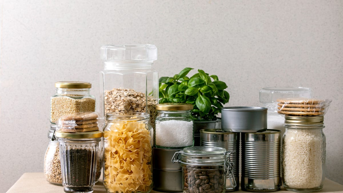 Several jars contain grains and beans
