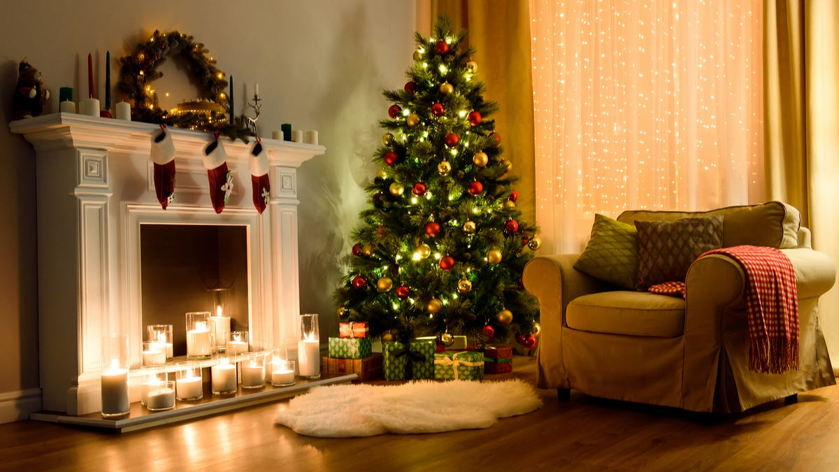 A Christmas tree is lit up in a living room.