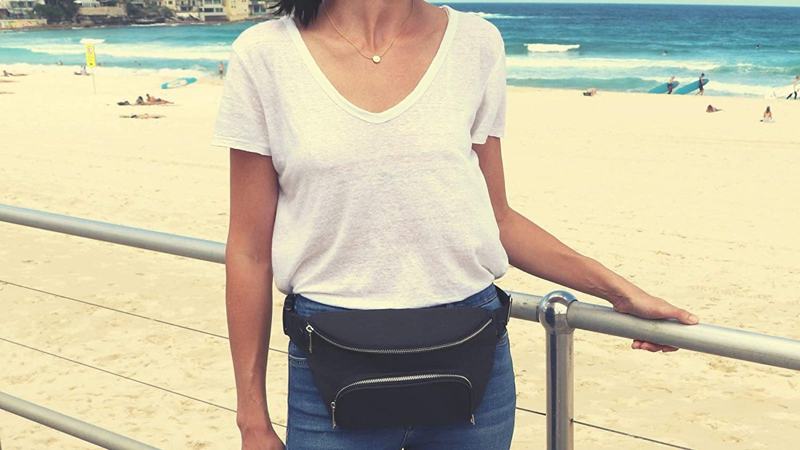 woman in white t-shirt wearing black belt bag