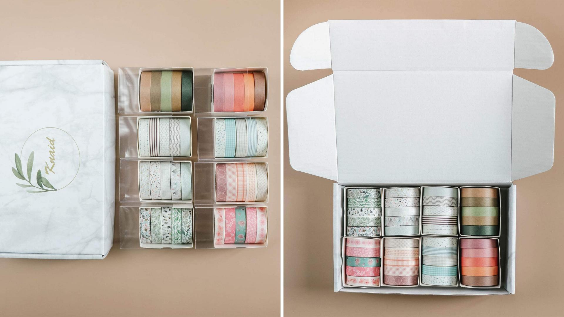 Plusieurs rouleaux de ruban washi sont dans une boîte.