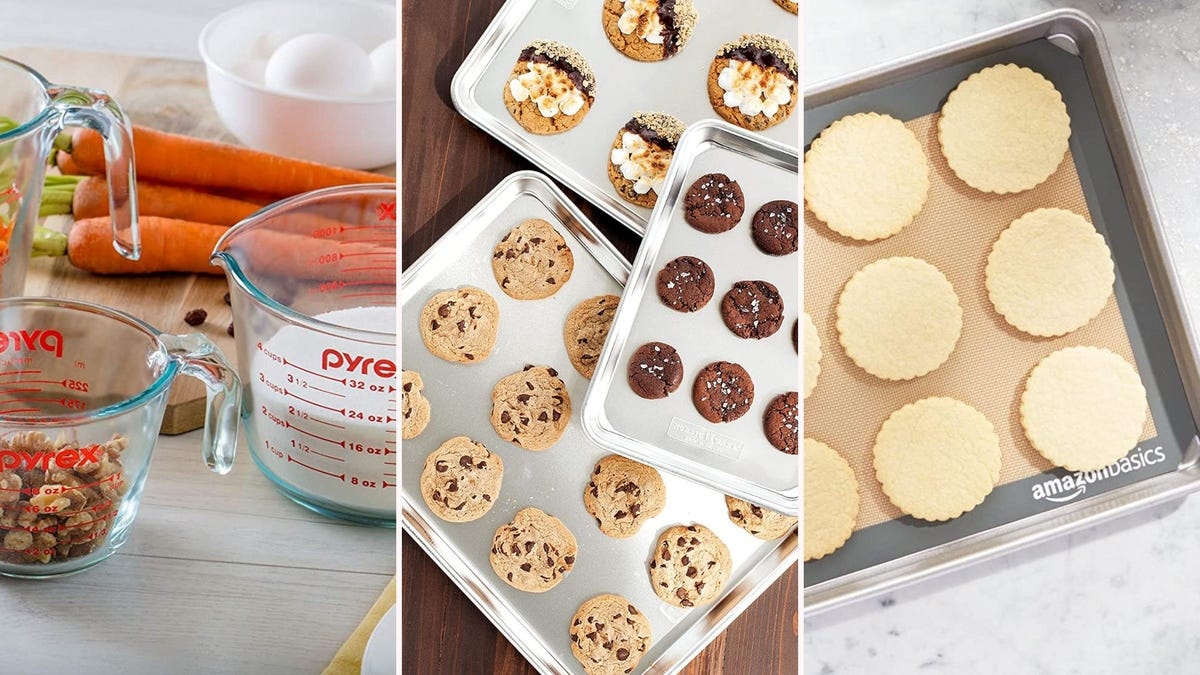 Measuring cups with ingredients; cookies on cookie sheets