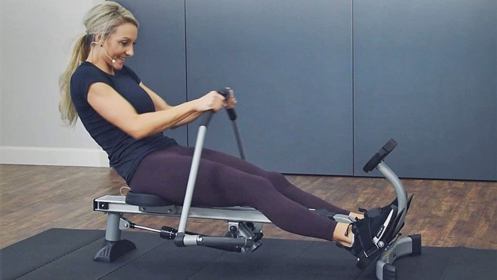 A woman using the Stamina BodyTrac Glider Rowing Machine 1052.