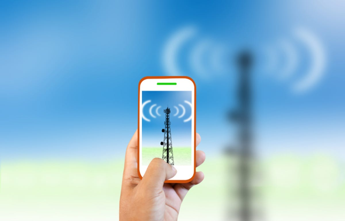 person holding a cell phone trying to connect to a cell tower