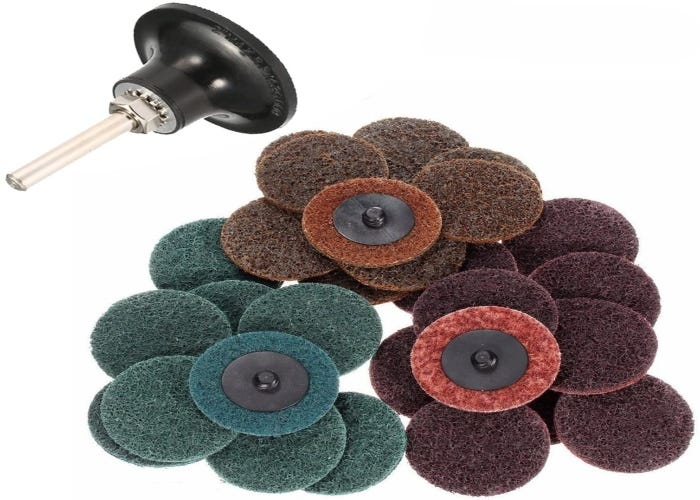 pile of sanding discs in three different colors with a sanding attachment