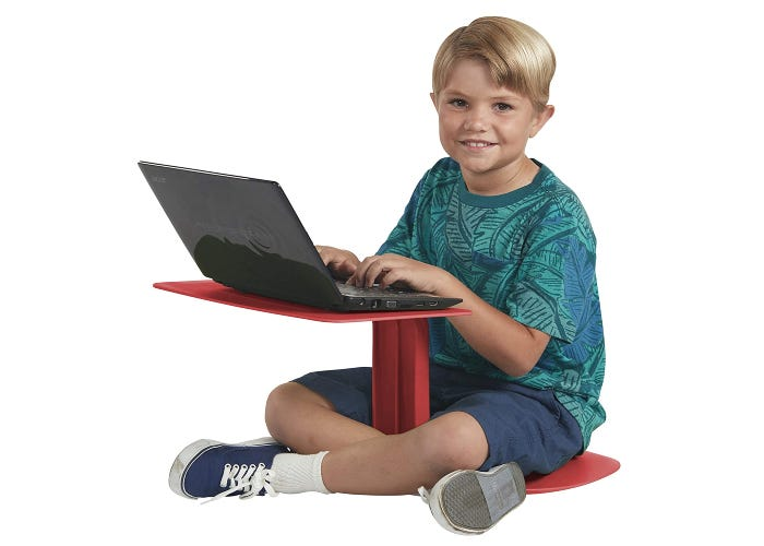 young boy using a laptop on top of a red lap desk and chair combination