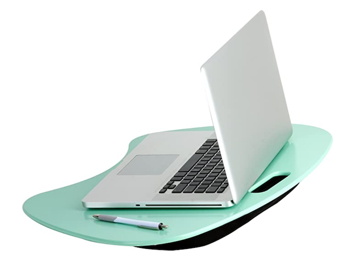 silver laptop and pen on top of a mint green lap desk with a small black cushion