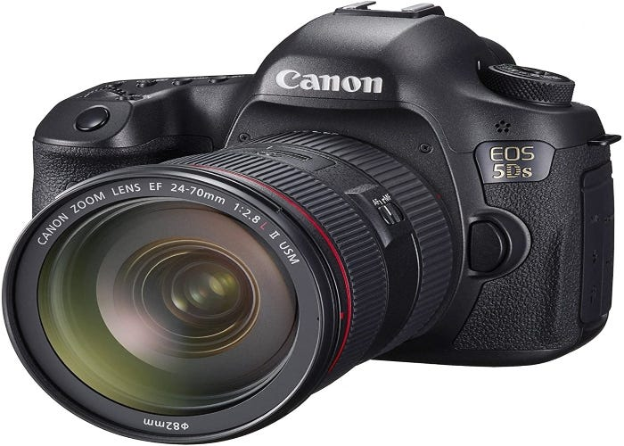 Canon digital SLR camera with an extended lens