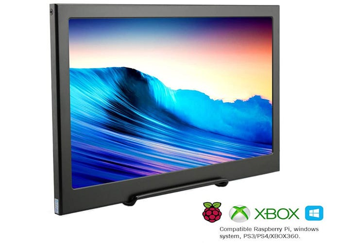 large dark gray display monitor showing a picture of an ocean wave at sunset