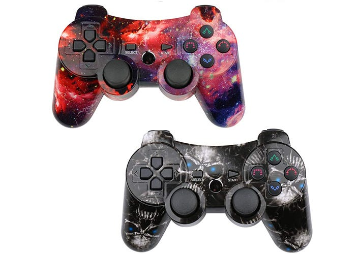 two wireless galaxy-patterned PS3 controllers, one red and one black