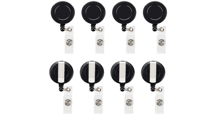 eight round, black badge reels with narrow silver hooks