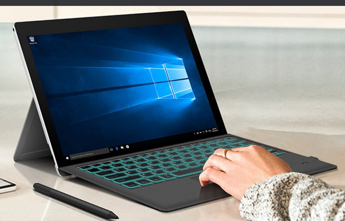 person using a Surface Pro with a type cover