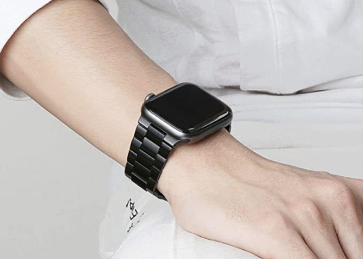 an Apple watch on a dark gray metal wristband
